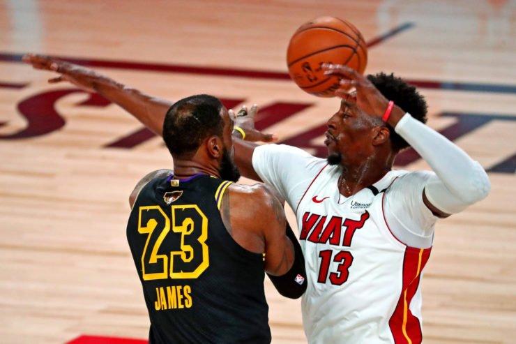 Los Angeles Lakers forward LeBron James against Bam Adebayo of Miami Heat
