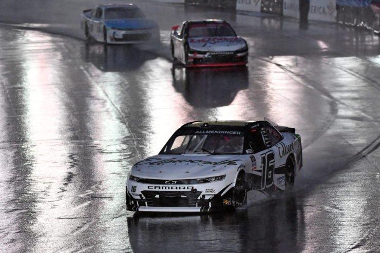Noah Gragson and AJ Allmendinger driving in the Charlotte Roval NASCAR Xfinity race