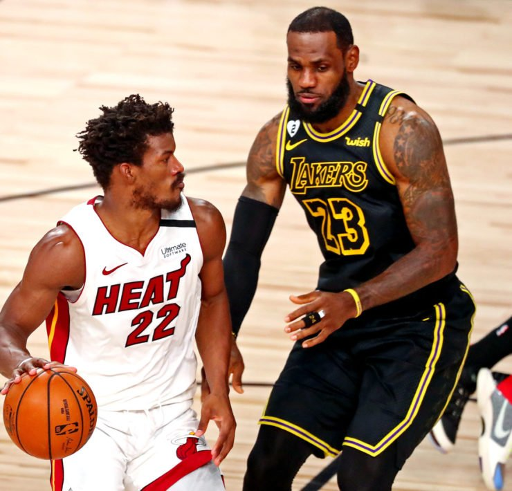 MIami Heat's Jimmy Butler Guarded By Lakers forward LeBron James