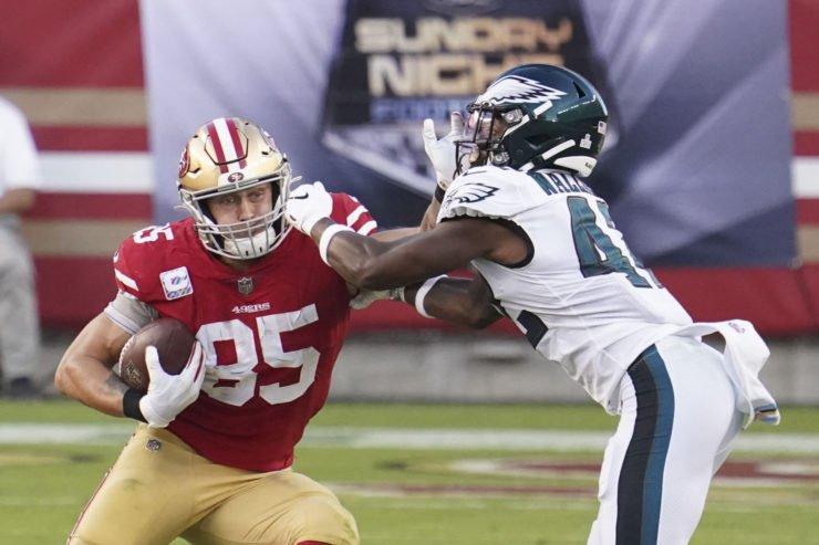 San Francisco 49ers tight end George Kittle defends against Philadelphia Eagles.