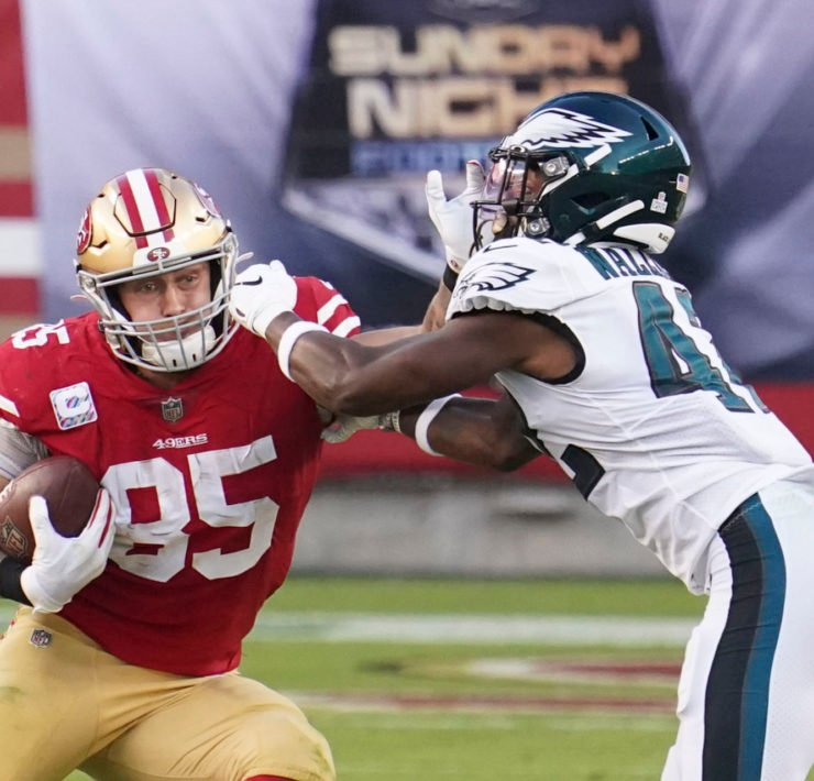 San Francisco 49ers tight end George Kittle defends against Philadelphia Eagles.