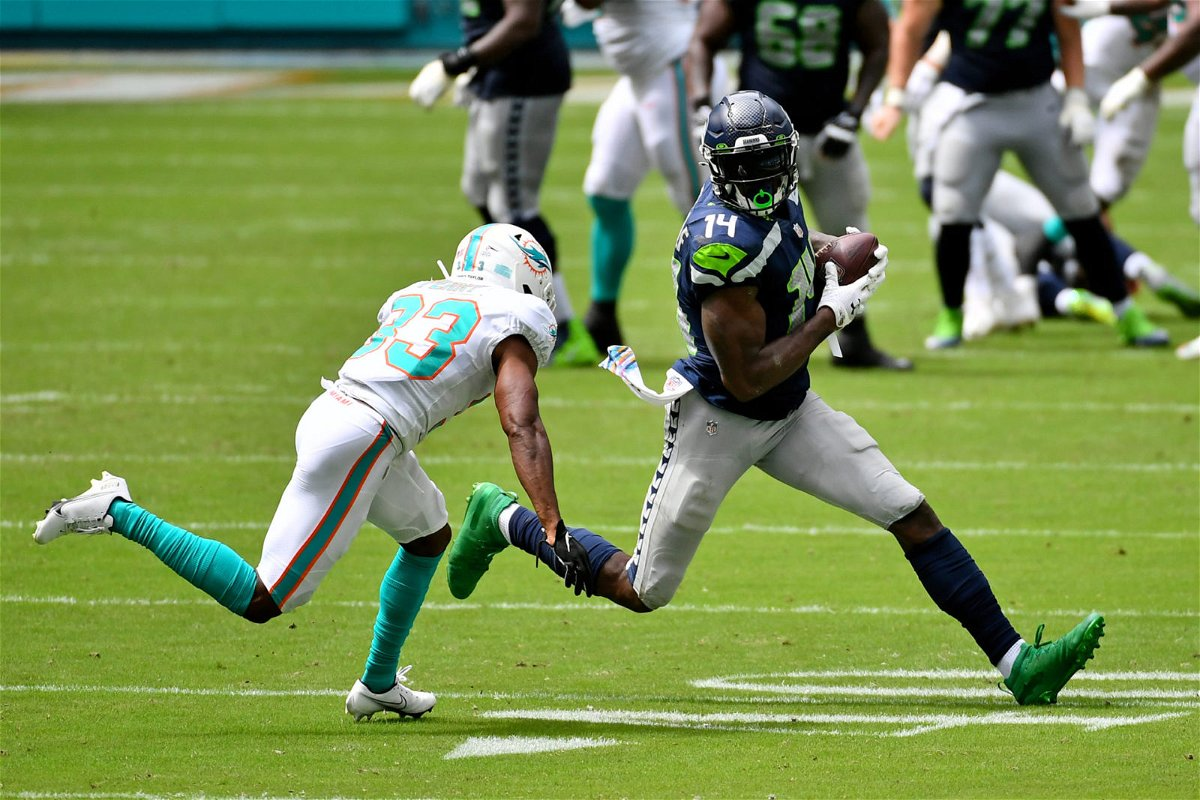 Seattle Seahawks wide receiver DK Metcalf runs with the ball against Miami Dolphins.