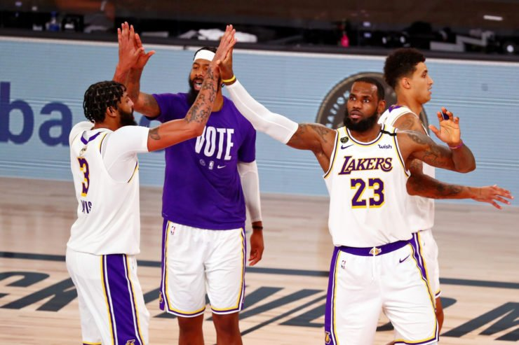 Los Angeles Lakers forward Anthony Davis (left) high fives forward Markieff Morris and LeBron James
