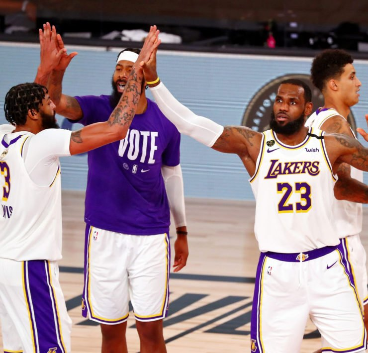 Los Angeles Lakers forward Anthony Davis (left) high fives forward Markieff Morris and LeBron James