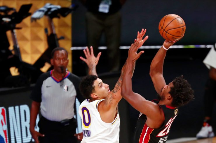 Miami Heat forward Jimmy Butler shoot against Los Angeles Lakers forward Kyle Kuzma