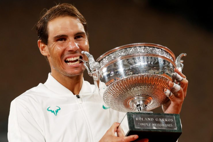 Rafael Nadal celebrates with the trophy at French Open 2020