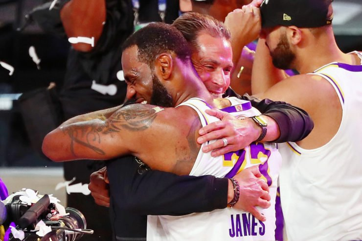 Los Angeles Lakers forward LeBron James hugs general manager Rob Pelinka