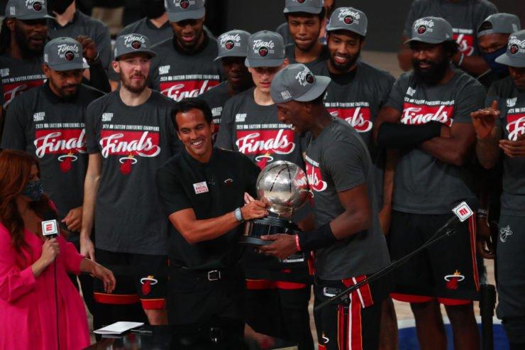 Miami Heat Head Coach Erik Spoelstra Hands Eastern Conference Championship Trophy to Bam Adebayo