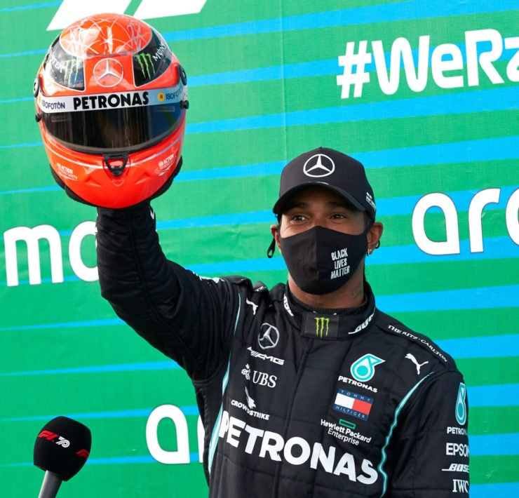 Mercedes' Lewis Hamilton holding Michael Schumacher's helmet after the race win at Eifel grand Prix 2020