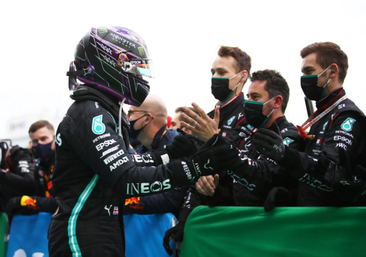 Mercedes driver Lewis Hamilton celebrates winning the Eifel GP with his team