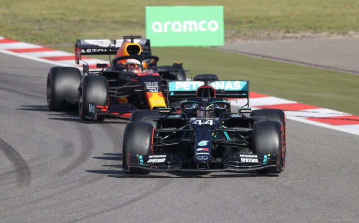 The Mercedes of Lewis Hamilton ahead of Max Verstappen's Red Bull during the safety car period at the Nurburgring