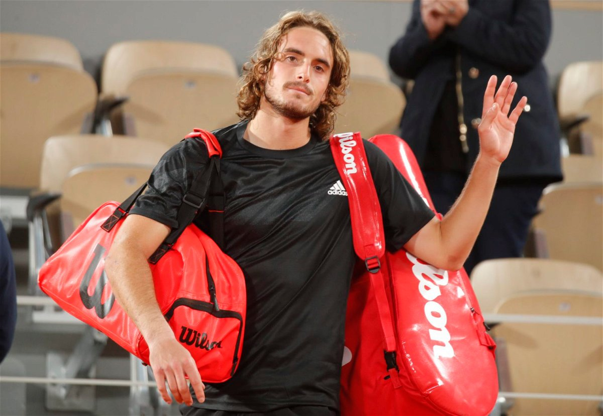 Stefanos Tsitsipas waves to the crowd after his French Open 2020 semi-final