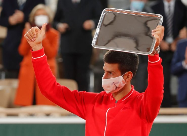 Novak Djokovic holding his runner up trophy in the French Open 2020