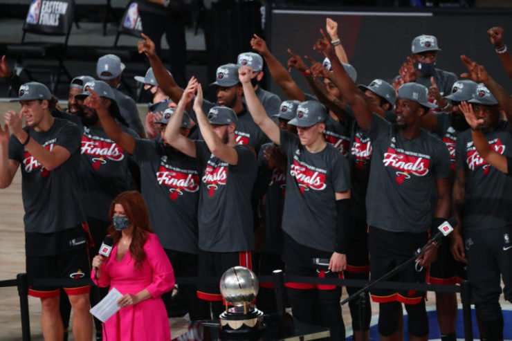 The Miami Heat applaud as they receive the Eastern Conference Championship trophy