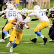 Los Angeles Chargers quarterback Justin Herbert attempts to make a play against New Orleans Saints on Monday.
