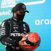 Lewis Hamilton with Michael Schumacher's helmet after the Eifel GP