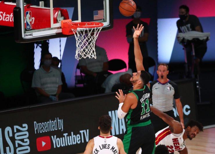 Boston Celtics' Enes Kanter attempts a shot against the Miami Heat