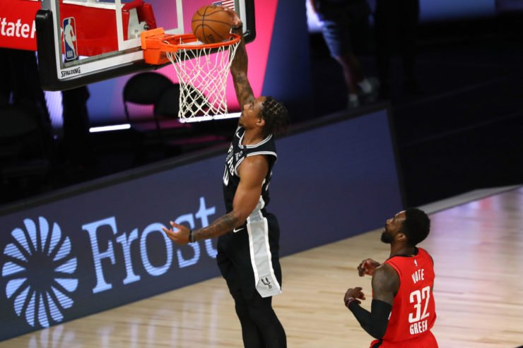 DeMar DeRozan #10 of the San Antonio Spurs dunks the ball in front of Jeff Green #32 of the Houston Rockets during the first half of a NBA basketball game at The Field House at ESPN Wide World Of Sports Complex on August 11, 2020