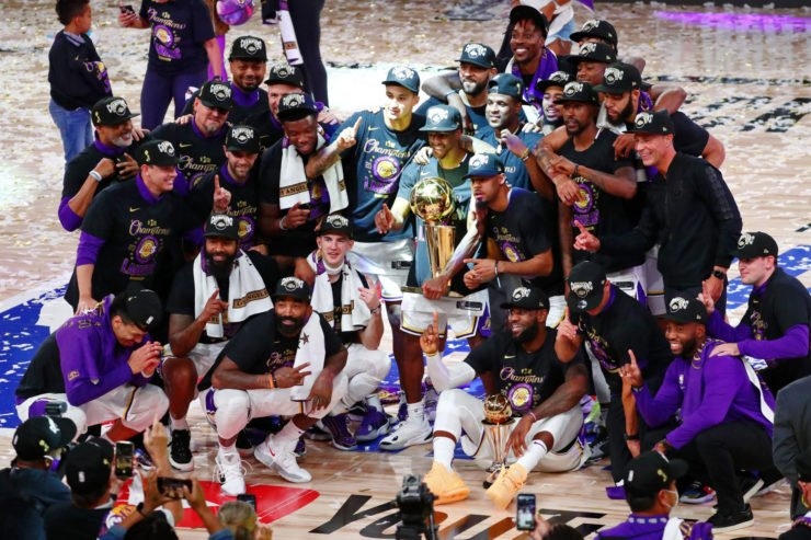 Los Angeles Lakers pose with the trophy after becoming 2020 NBA champions