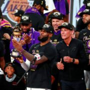 Los Angeles Lakers' LeBron James pose with the Finals MVP trophy after becoming 2020 NBA champions