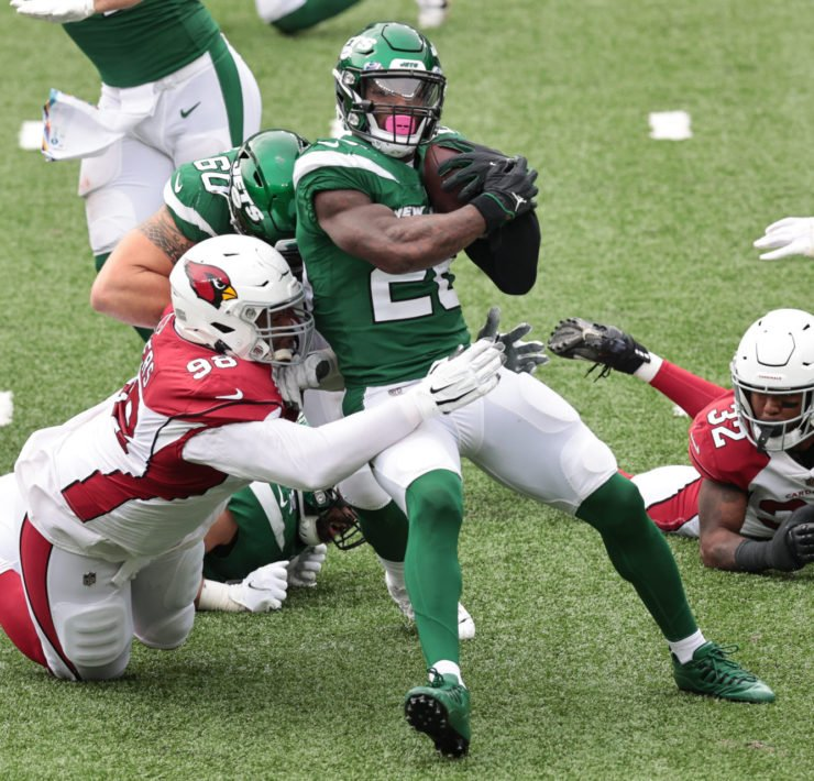 New York Jets running back Le'Veon Bell attempts to hold on to the ball against Arizona Cardinals in Week Five.