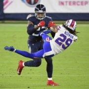 Tennessee Titans running back Derrick Henry tackles Buffalo Bills' John Norman on Tuesday night.