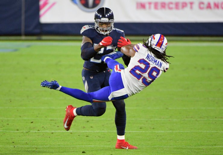 Tennessee Titans running back Derrick Henry tackles Buffalo Bills' John Norman on Tuesday night.
