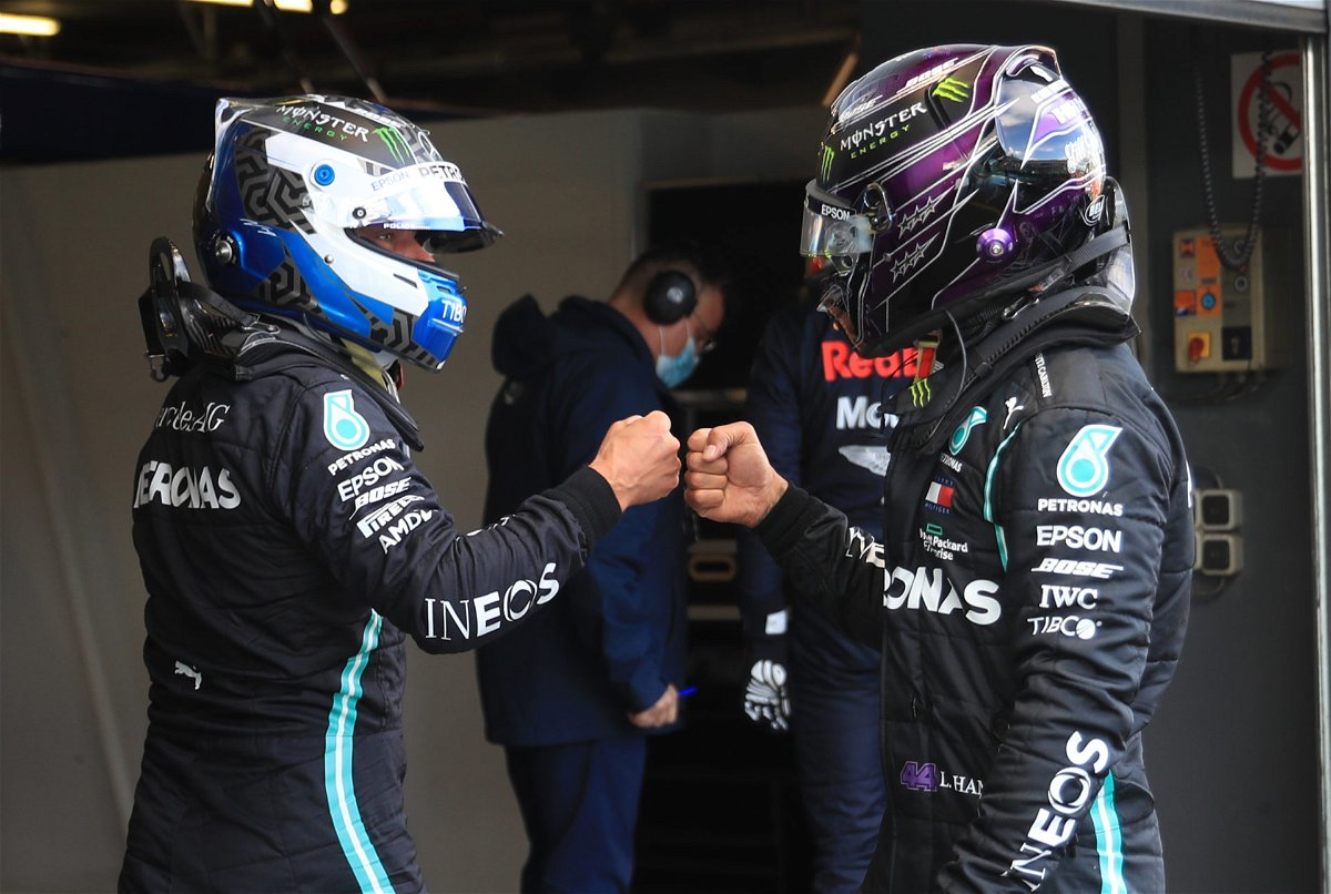 Lewis Hamilton and Valtteri Bottad fist bump after the latter takes pole at the Nurburgring