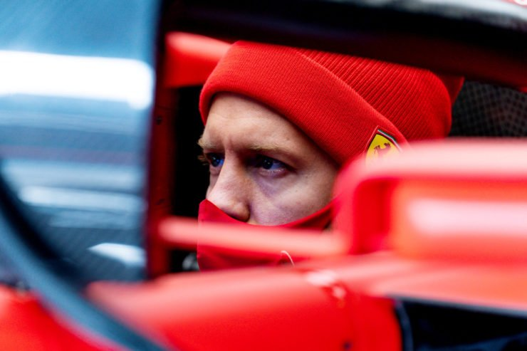 Ferrrai driver Sebastian Vettel looks on ahead of the Eifel GP
