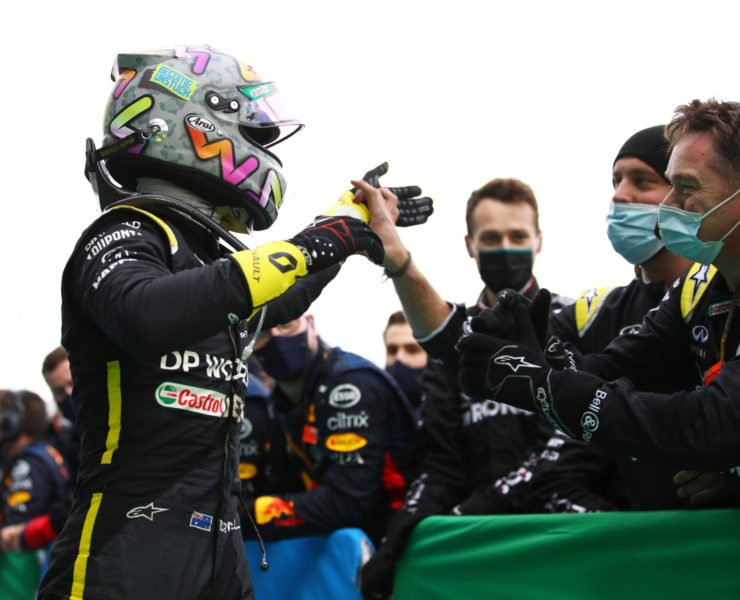 Renault F1's Daniel Ricciardo celebrates his podium finish with the team