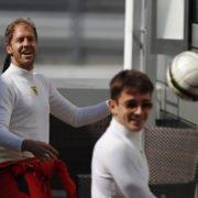 Ferrari's Sebastian Vettel and Ferrari's Charles Leclerc play football ahead of the race.