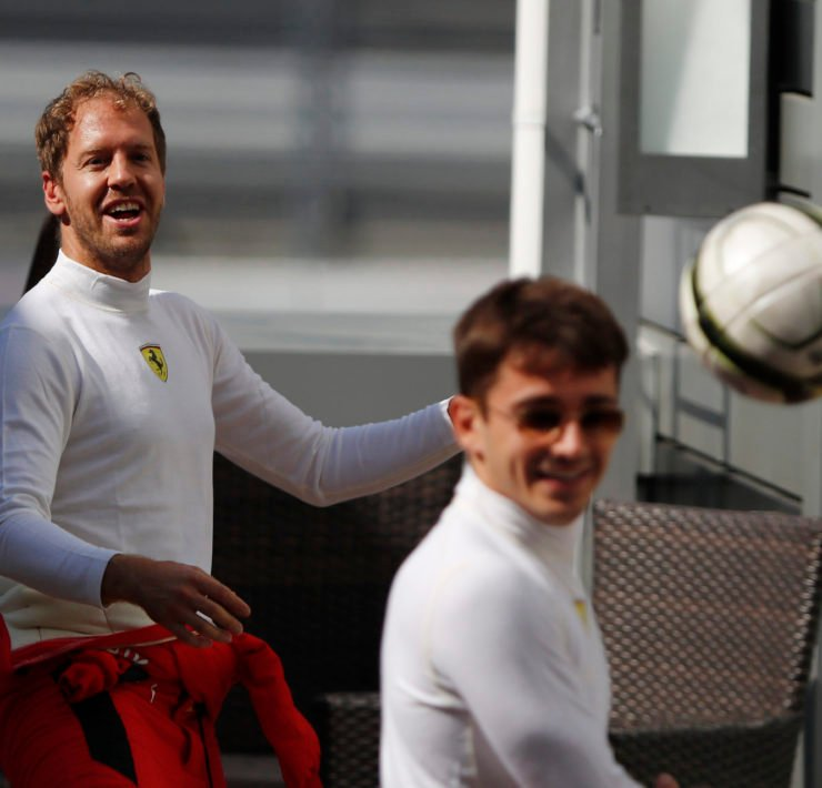 Ferrari's Sebastian Vettel and Ferrari's Charles Leclerc play football ahead of the race.