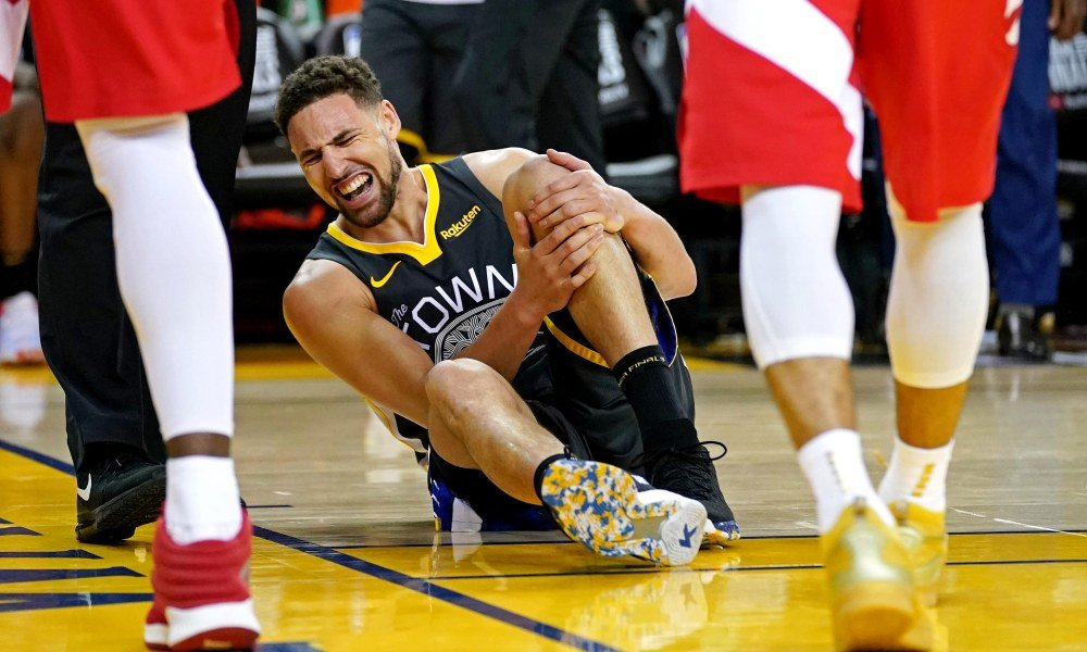 Golden State Warriors guard Klay Thompson (11) reacts after an injury during the third quarter against the Toronto Raptors in game six of the 2019 NBA Finals at Oracle Arena.