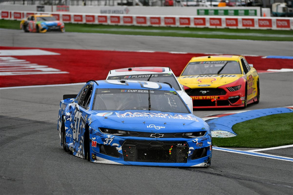 NASCAR Cup Series driver Ryan Preece (37) leads Alex Bowman (88) and Joey Logano (22) races during the Bank of America ROVAL 400 at Charlotte Motor Speedway