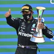 Mercedes driver Lewis Hamilton celebrates winning the Eifel GP
