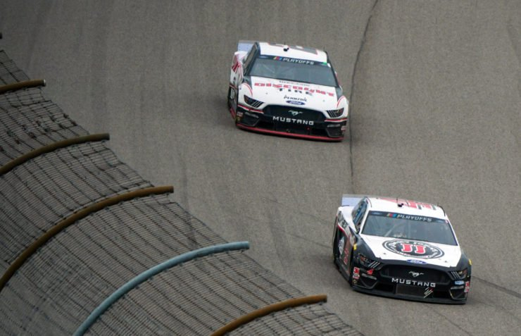 Kevin Harvick and Brad Keselowski in action in NASCAR Cup Series race at Kansas Speedway