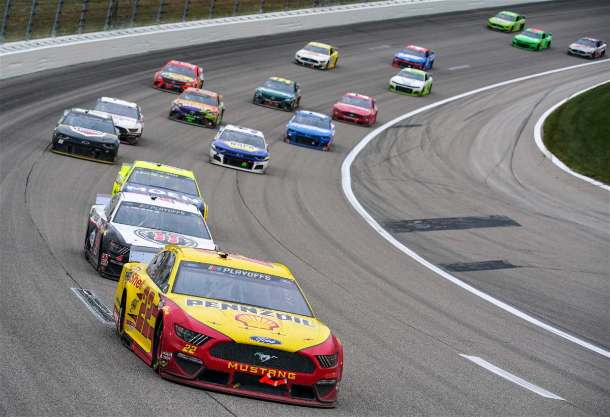 Joey Logano leads the field in the NASCAR Cup Series race at Kansas Speedway