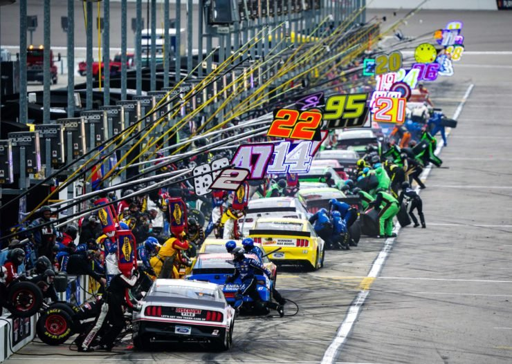 NASCAR Cup Series drivers during a pit-stop at Kansas Speedway