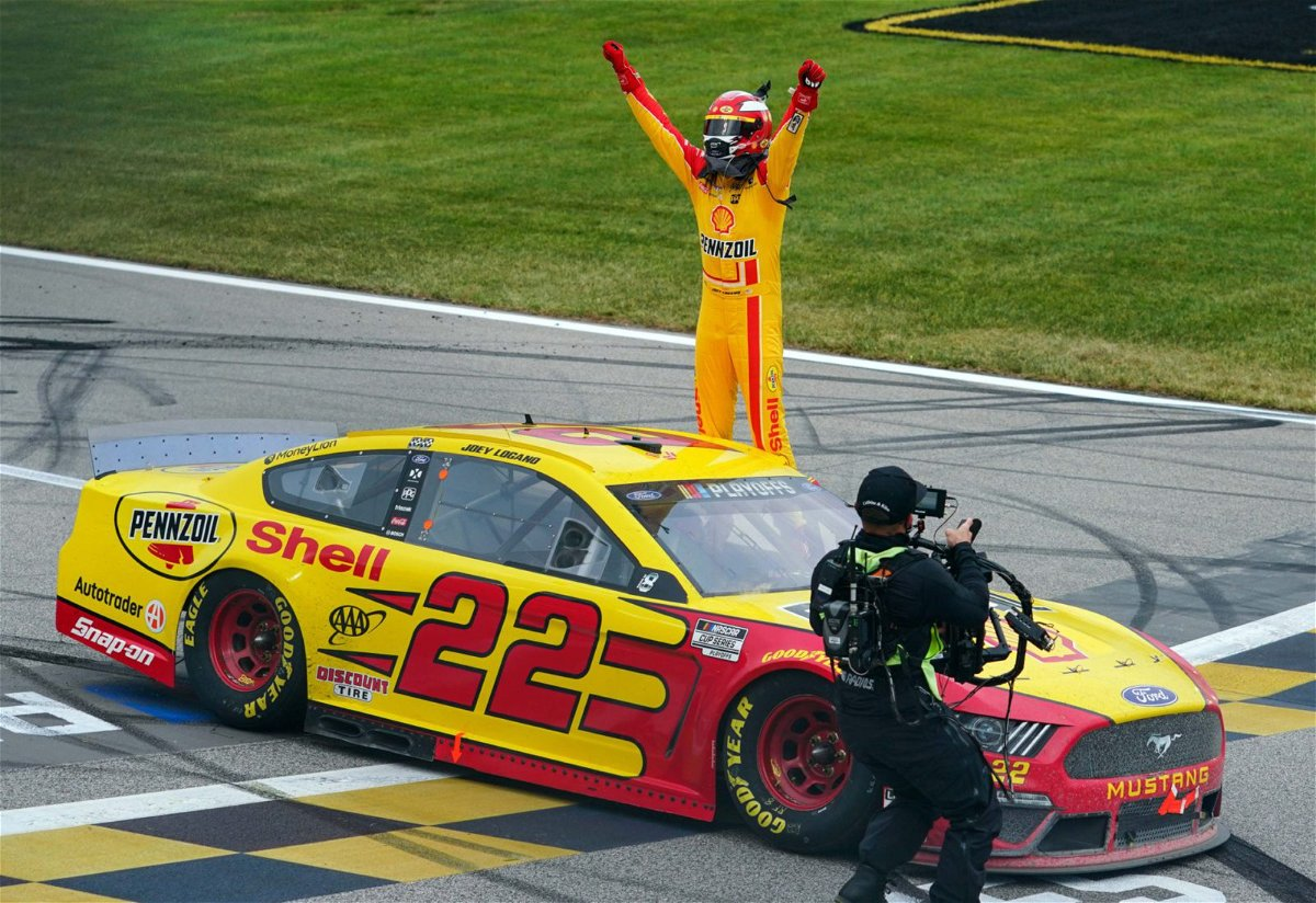 Joey Logano celebrates his win in the NASCAR Cup Series race at Kansas Speedway