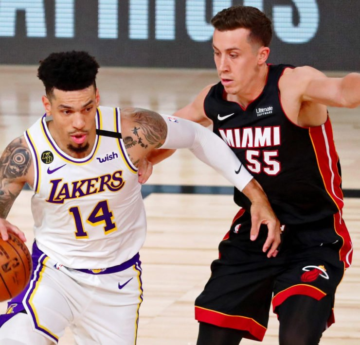 Los Angeles Lakers' Danny Green dribbles past Miami Heat's Duncan Robinson