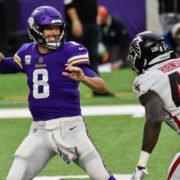 Minnesota Vikings quarterback Kirk Cousins attempts to make a pass against Atlanta Falcons on Sunday.
