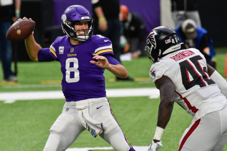 Minnesota Vikings quarterback Kirk Cousins attempts to make a pass against Atlanta Falcons on Sunday.