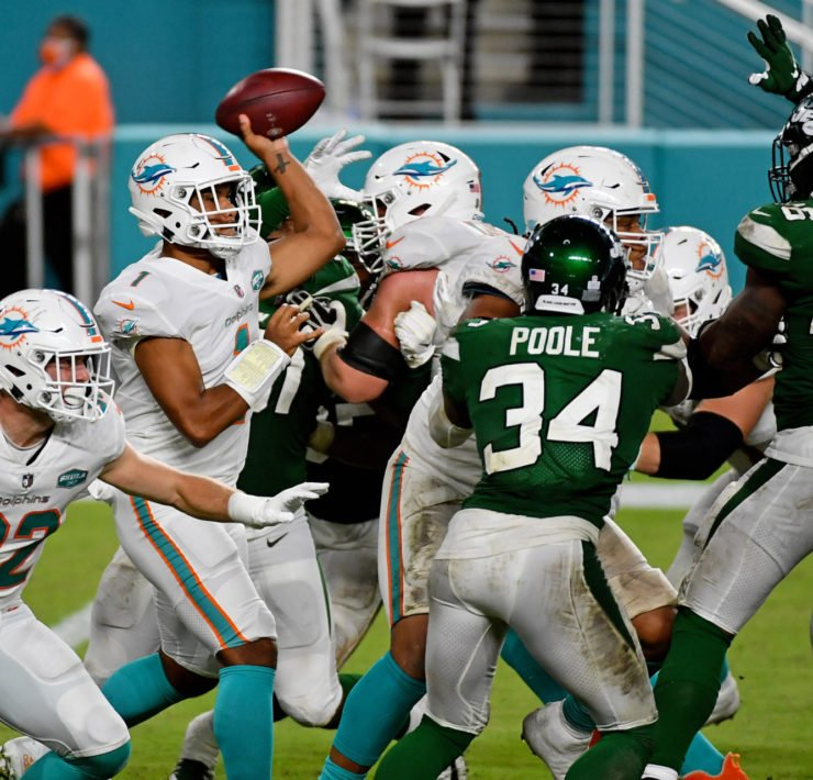 Miami Dolphins quarterback Tua Tagovailoa attempts to make a pass against New York Jets on Sunday.