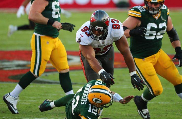 Tampa Bay Buccaneers defensive end Ndamukong Suh sacks Green Bay Packers quarterback Aaron Rodgers.