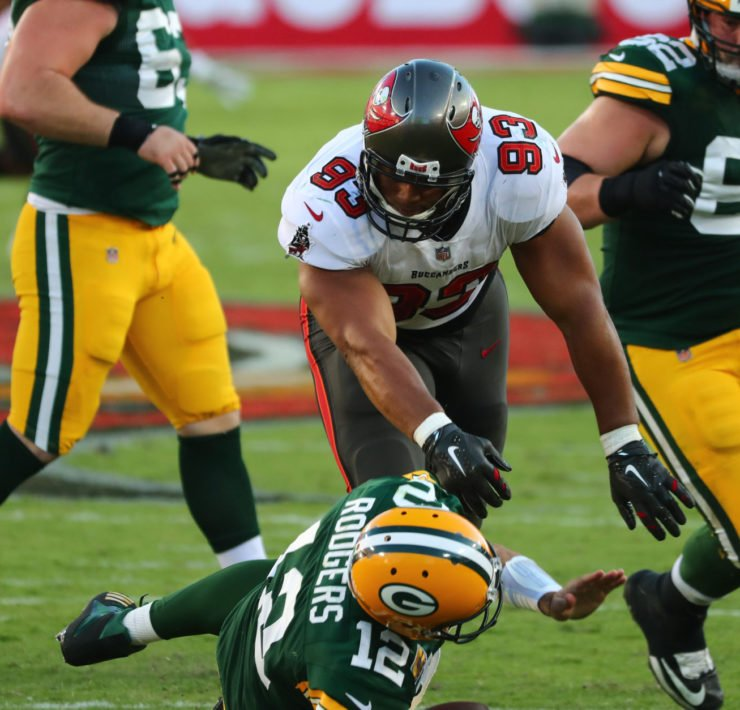 Tampa Bay Buccaneers defensive end Ndamukong Suh sacks Green Bay Packers quarterback Aaron Rodgers.