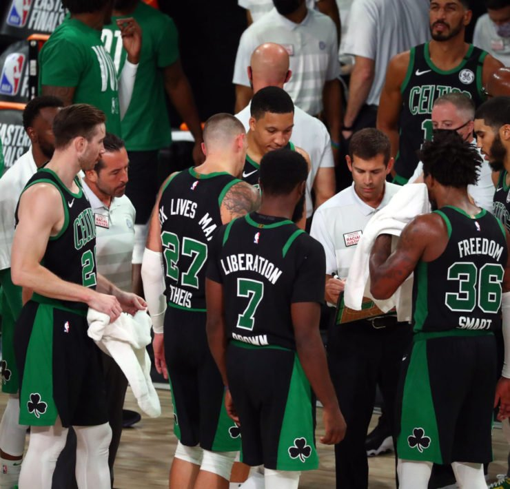 Boston Celtics players in a huddle during the Eastern Conference Finals