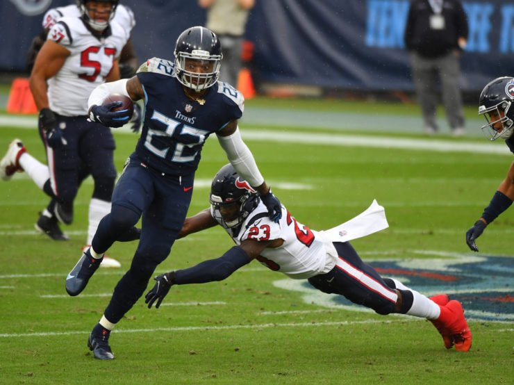 Tennessee Titans running back Derrick Henry rushes with the ball against the Houston Texans in Week Six.