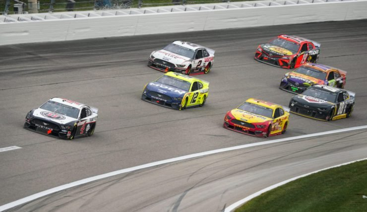 Kevin Harvick leads the other drivers during the NASCAR Cup Series race at Kansas Speedway