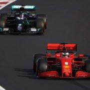 The Ferrari of Sebastian Vettel ahead of Lewis Hamilton's Mercedes during qualifying in Germany