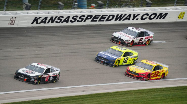 Kevin Harvick leads the field during the NASCAR Cup Series race at Kansas